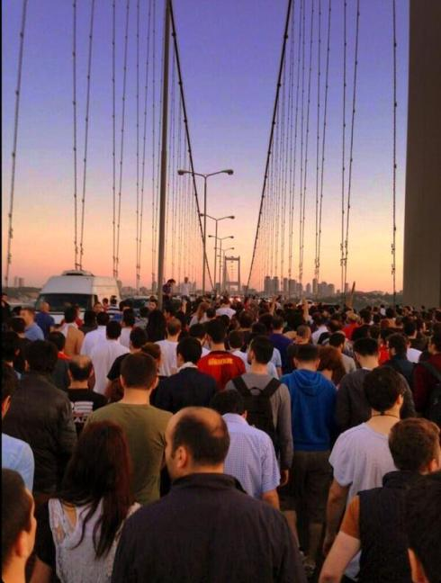 Turks crossing the Bosphorous Bridge going to Taksim
