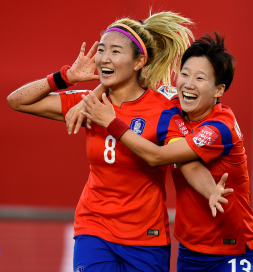 OTTAWA, ON - JUNE 17:  Sohyun Cho of Korea celebrates with Hahnul Kwon of Korea after scoring her teams first goal during the FIFA Women's World Cup 2015 Group E match between Korea Republic and Spain at Lansdowne Stadium on June 17, 2015 in Ottawa, Canada.  (Photo by Lars Baron - FIFA/FIFA via Getty Images)